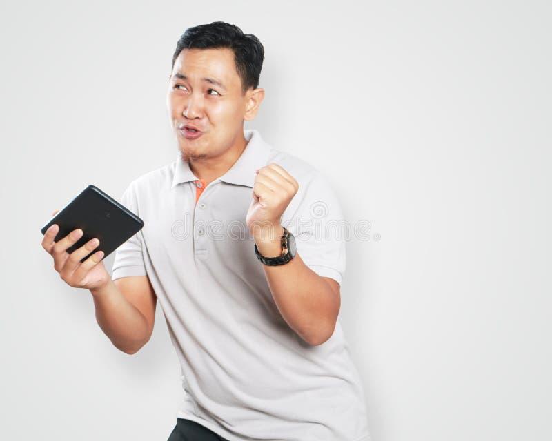 Giovane asiatico divertente Guy Dancing fotografie stock