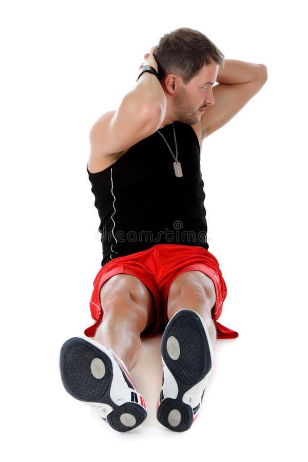 Giovane atleta caucasico attraente dell'uomo, mani in su fotografia stock libera da diritti
