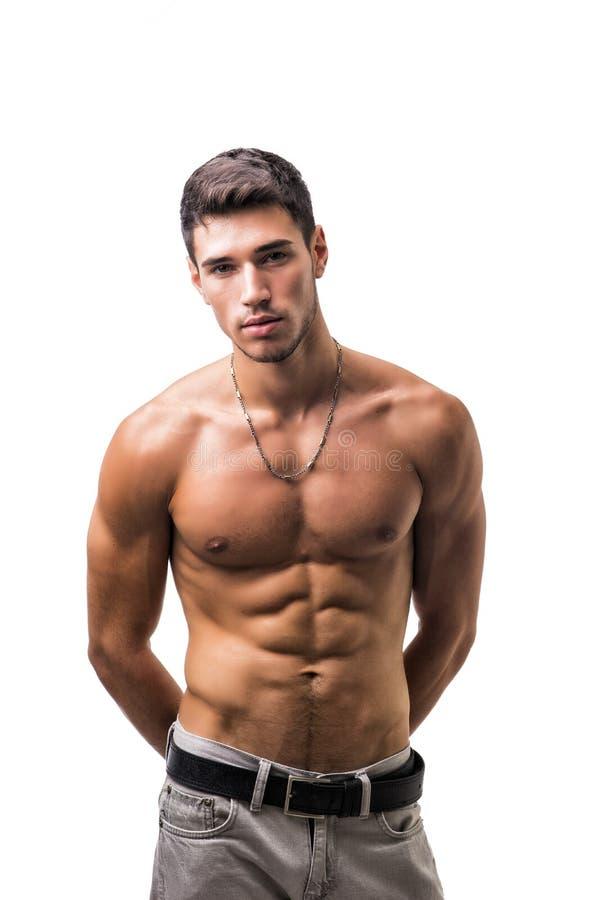 Giovane atletico senza camicia bello su bianco immagini stock libere da diritti