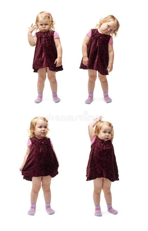 Giovane bambina che controlla fondo bianco isolato immagine stock libera da diritti