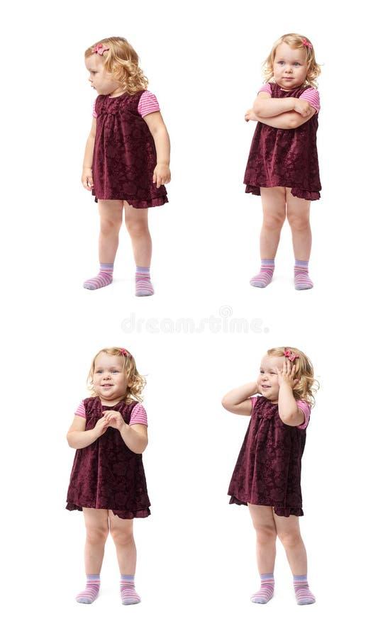 Giovane bambina che controlla fondo bianco isolato fotografie stock libere da diritti