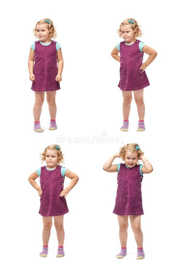 Giovane bambina che controlla fondo bianco isolato immagine stock