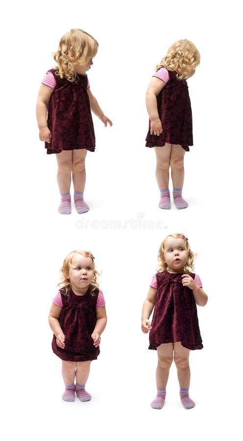 Giovane bambina che controlla fondo bianco isolato fotografia stock