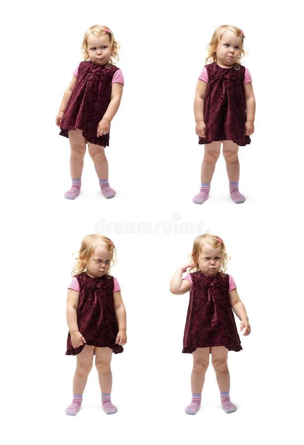 Giovane bambina che controlla fondo bianco isolato fotografie stock