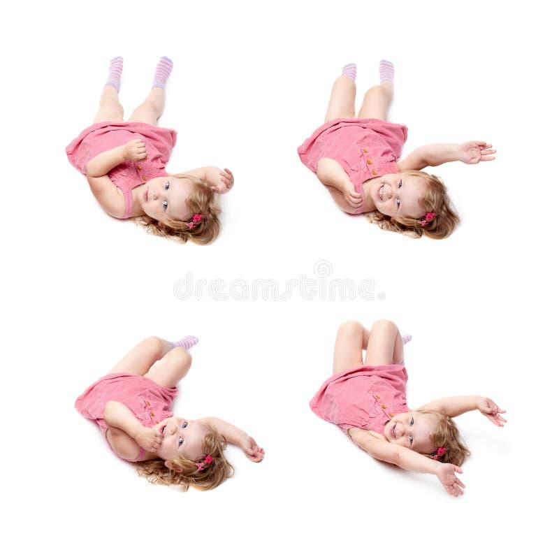 Giovane bambina che si trova sopra il fondo bianco isolato fotografia stock