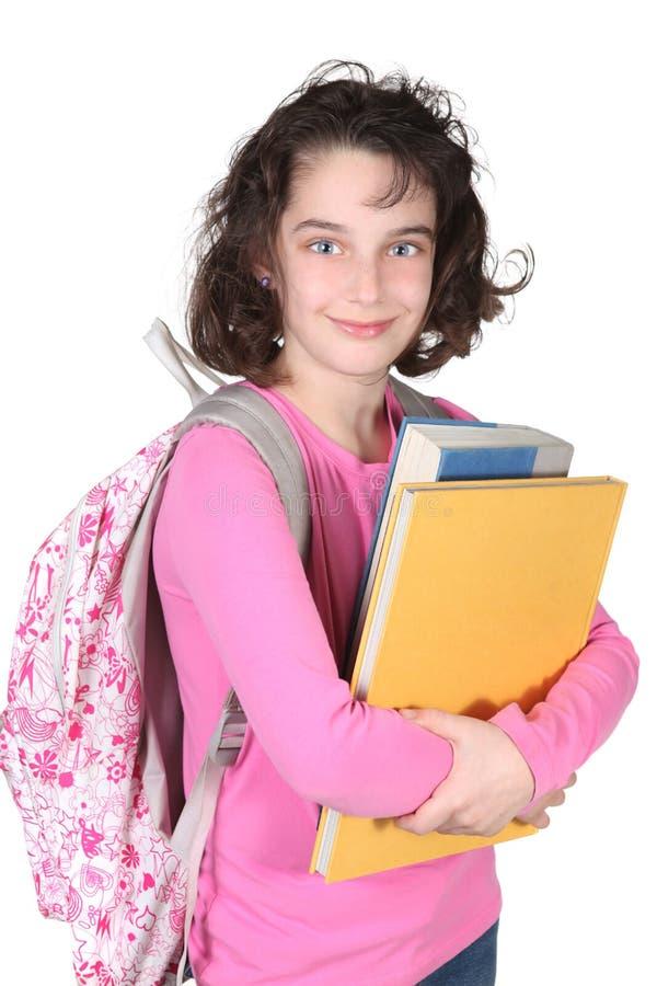 Giovane bambino della scuola elementare con lo zaino fotografia stock libera da diritti