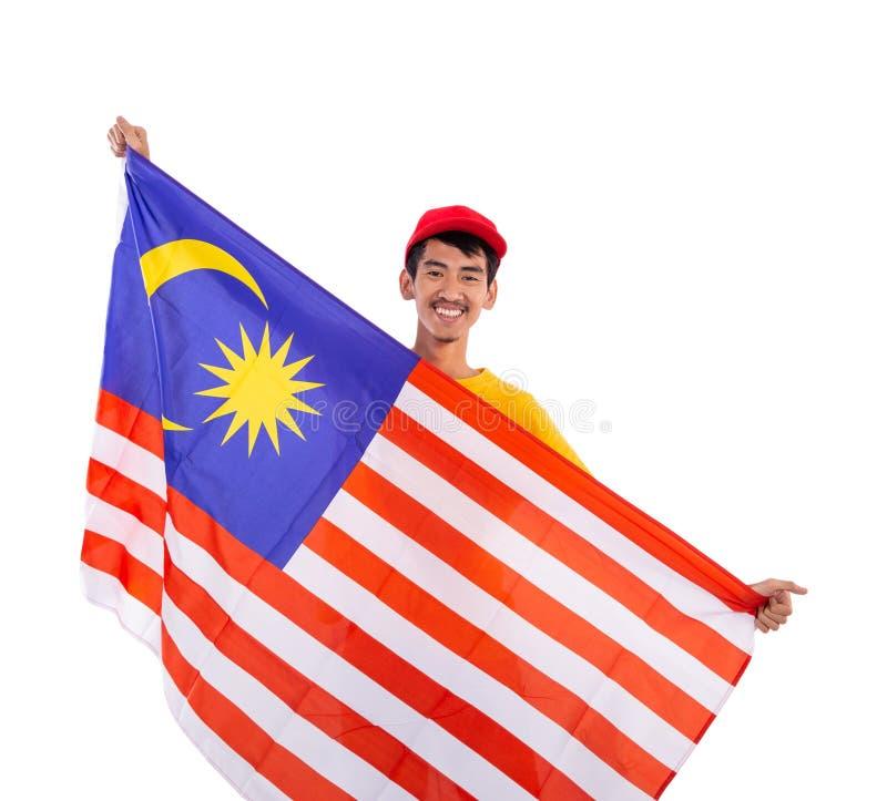 Giovane bandiera maschio asiatica della Malesia della tenuta fotografia stock