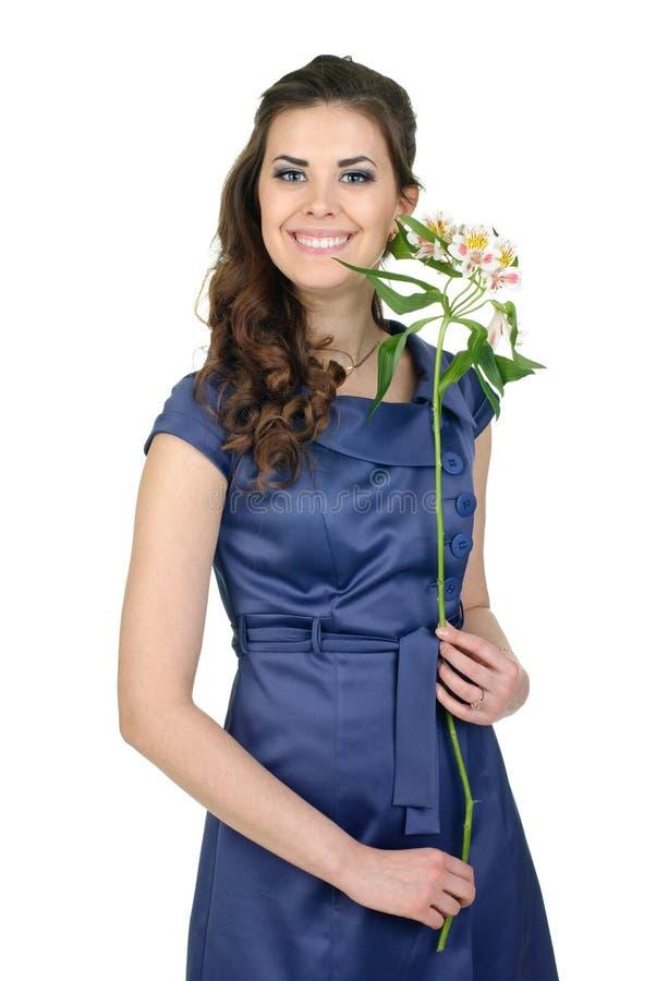 Giovane bella donna con il fiore immagini stock libere da diritti