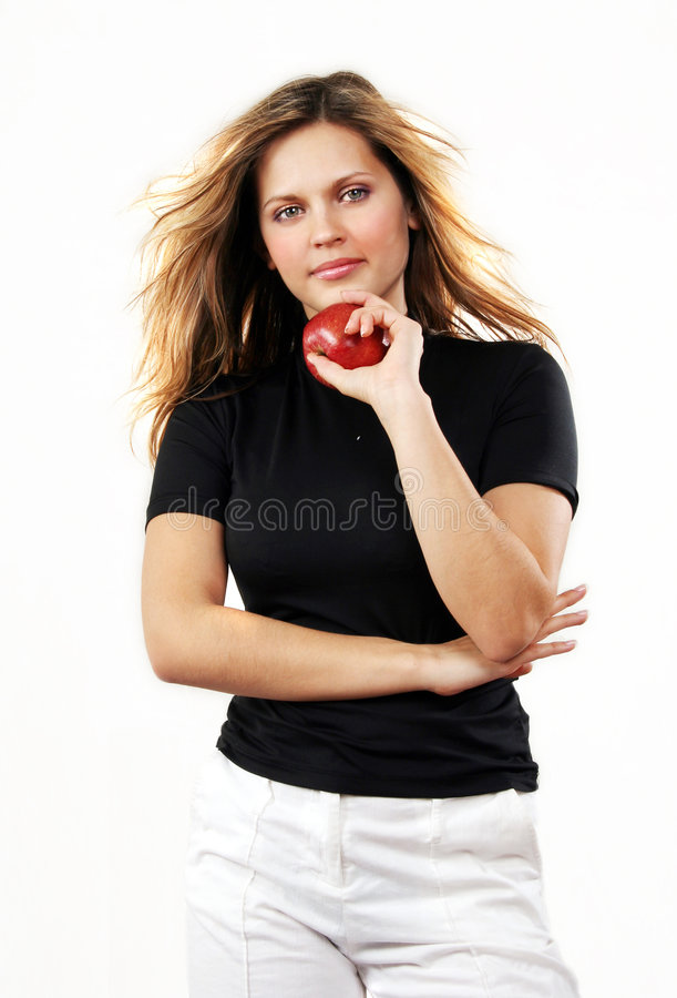 Giovane bella donna sexy con la mela rossa sul bianco immagini stock libere da diritti