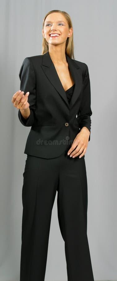 Giovane bella donna sorridente di affari immagine stock