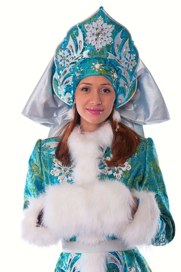 Giovane bella ragazza nel costume della ragazza della neve fotografia stock