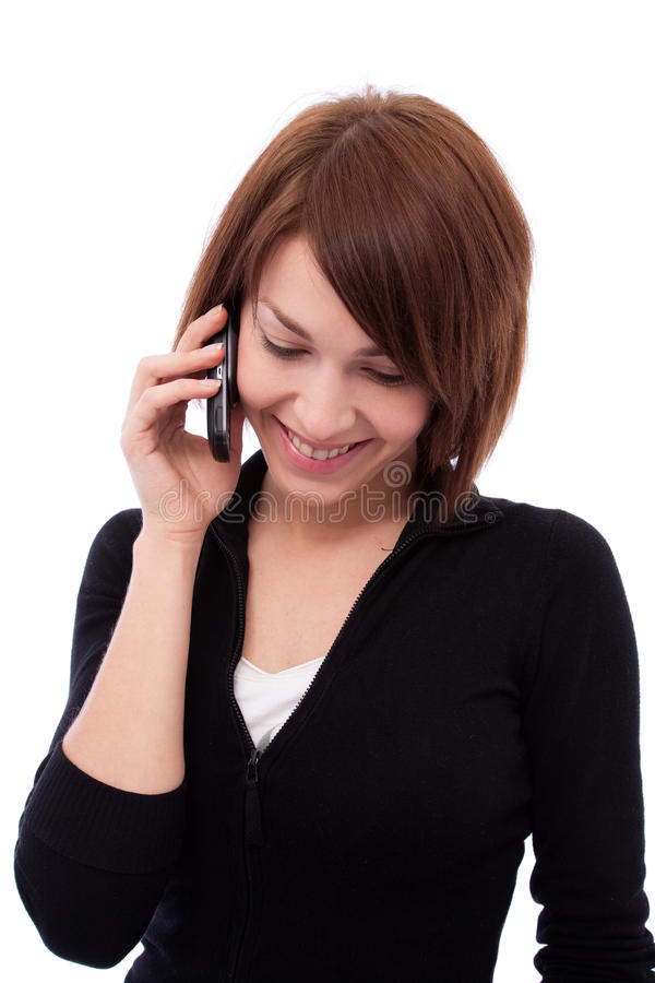 Giovane bella ragazza sul telefono fotografia stock libera da diritti