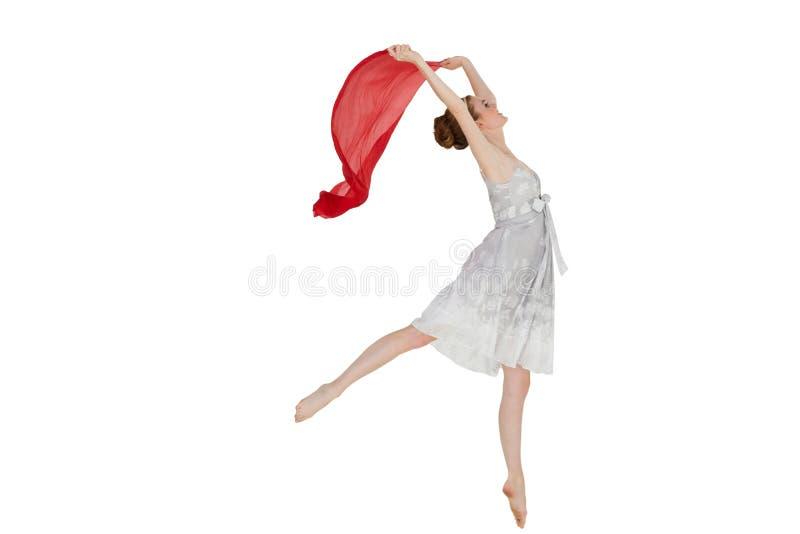 Giovane bello ballerino femminile con la sciarpa rossa immagine stock