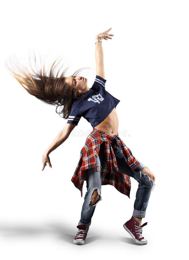 Giovane bello ballerino moderno che posa su un fondo dello studio fotografie stock