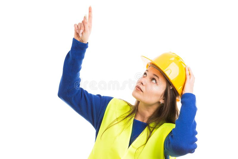 Giovane bello ingegnere femminile che indica su immagini stock