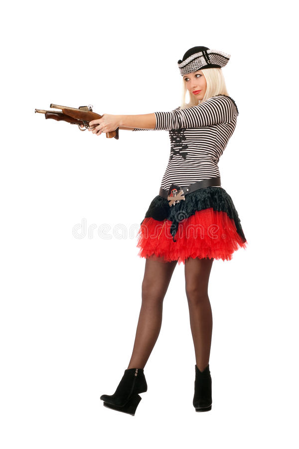 Giovane bionda stupefacente con le pistole fotografia stock libera da diritti