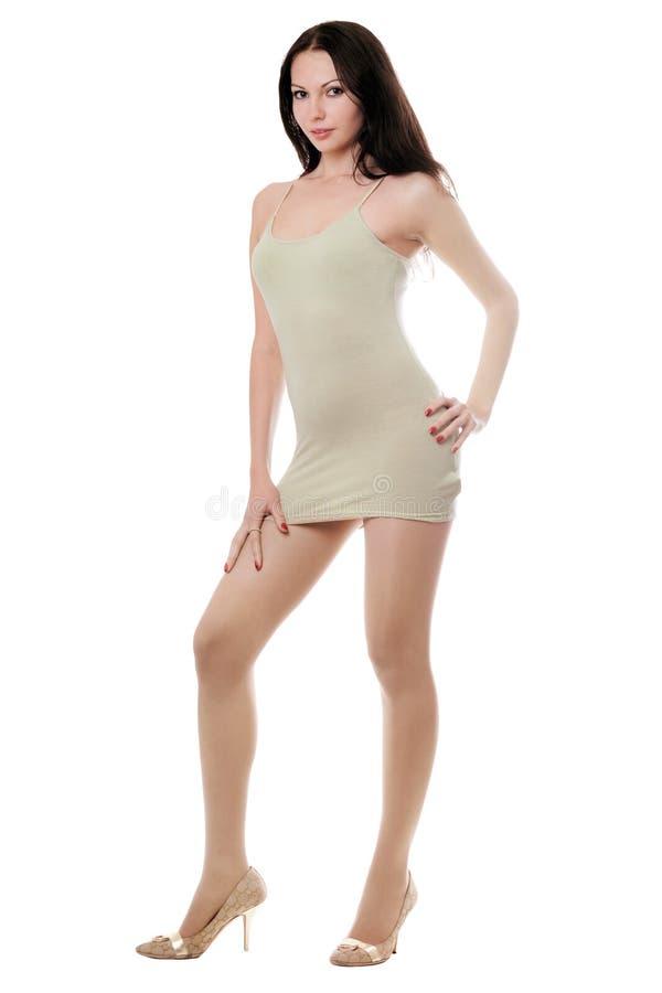 Giovane brunette in vestito fotografia stock