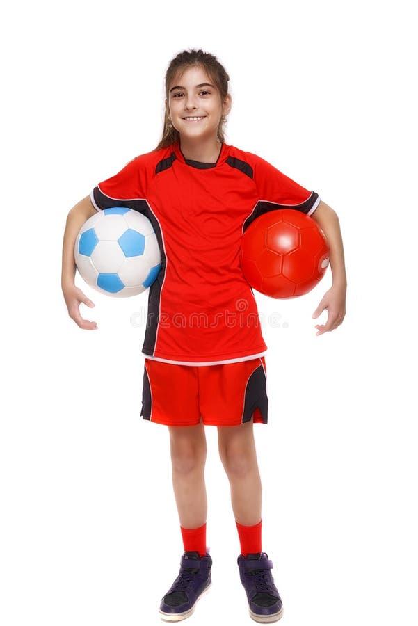 Giovane calciatore con la palla isolata su bianco fotografia stock