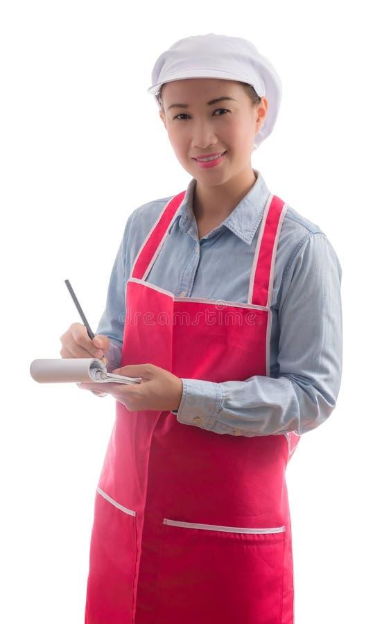Giovane cameriera di bar che prende ordine, isolato su fondo bianco immagine stock libera da diritti