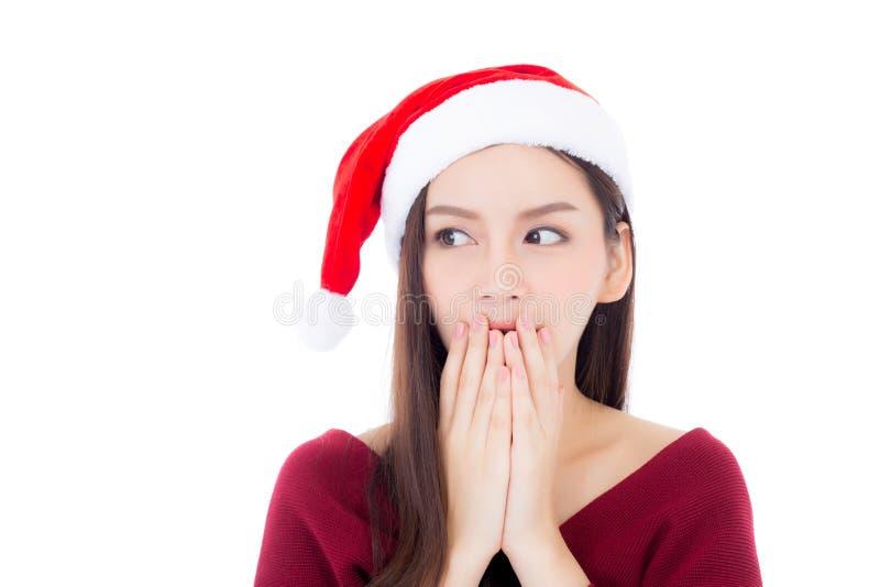 Giovane cappello asiatico di Santa di usura di donna del ritratto con sorpreso immagini stock