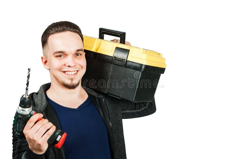 Giovane cassetta portautensili e cacciavite della tenuta del tipo, isolati su fondo bianco fotografia stock