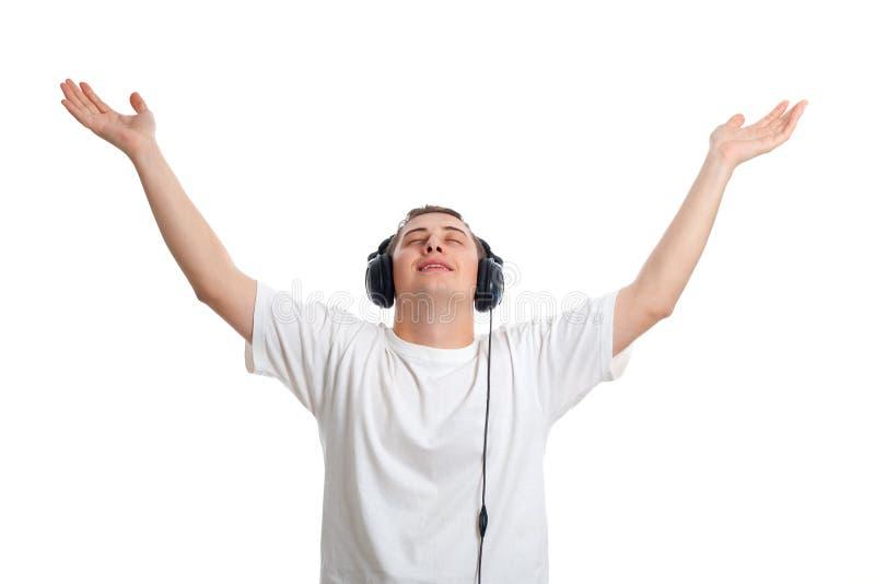Giovane che gode della musica immagini stock libere da diritti