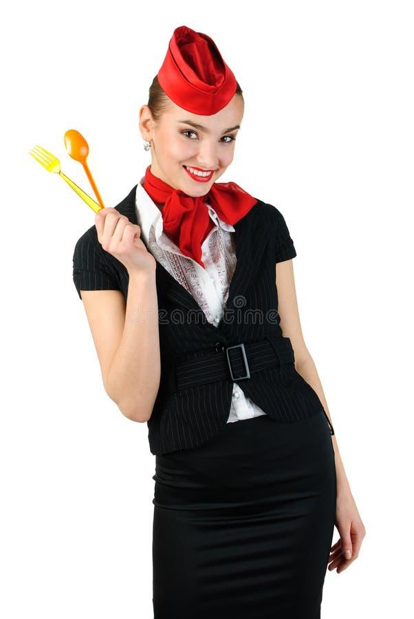 Giovane coltelleria della holding dello stewardess fotografia stock