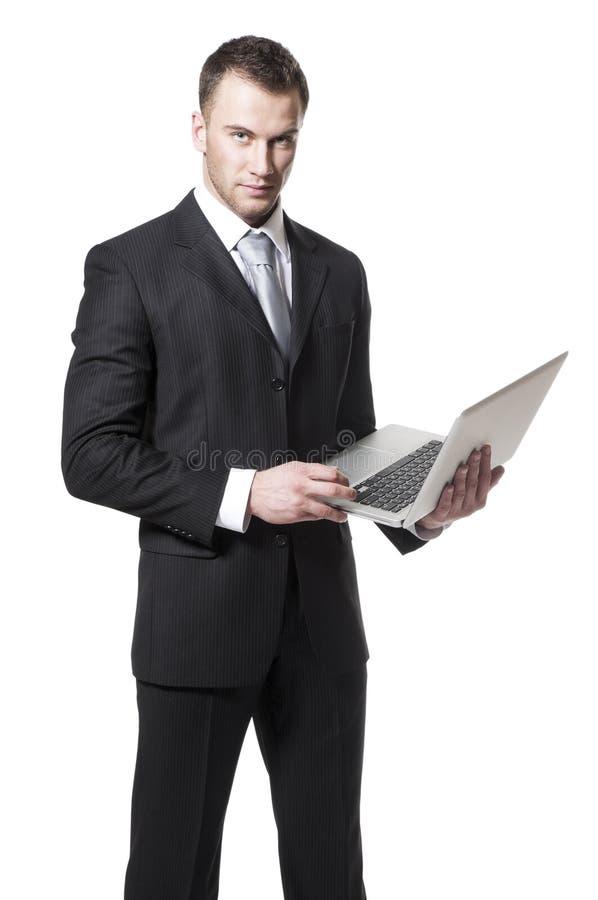 Giovane computer portatile della holding dell'uomo d'affari fotografia stock