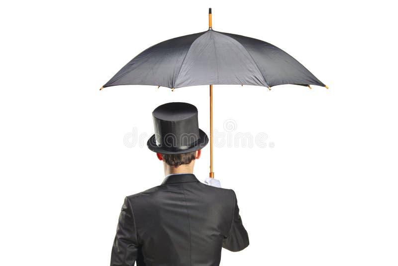 Giovane con i guanti che tengono un ombrello fotografie stock