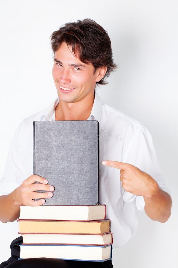 Giovane con i libri fotografie stock