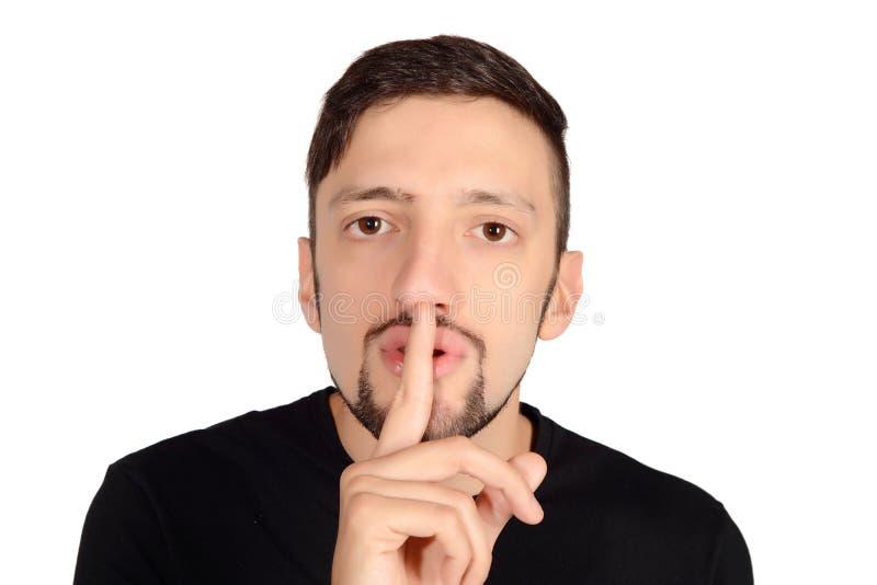Giovane con il dito sulle labbra che fanno silenzio immagini stock libere da diritti