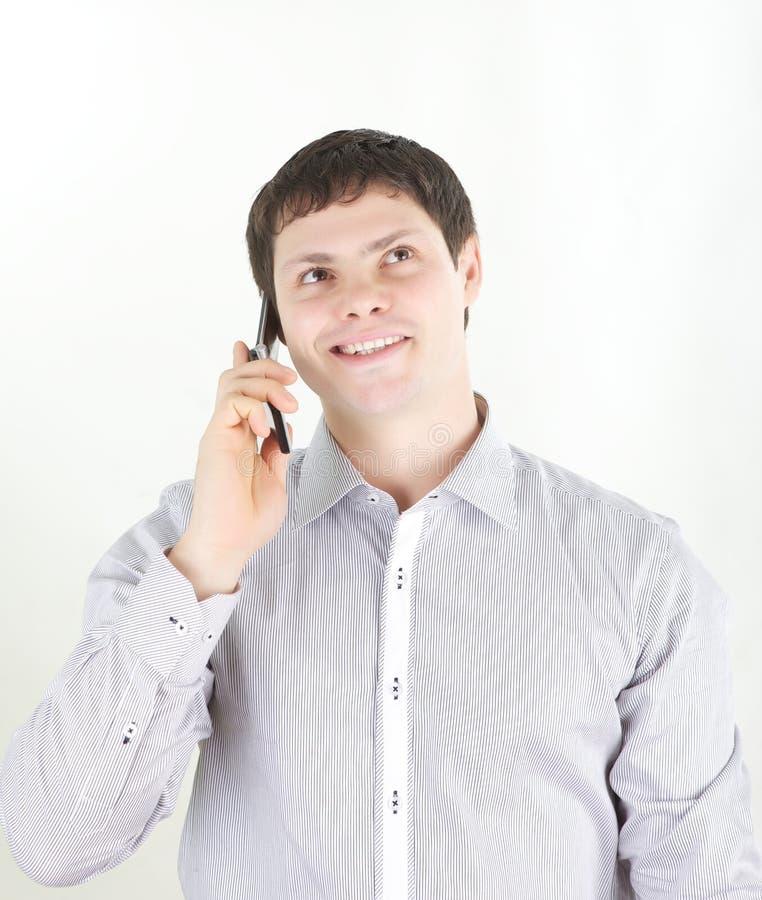 Giovane con il telefono fotografie stock
