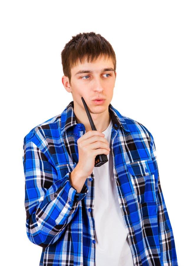 Giovane con il walkie-talkie immagini stock