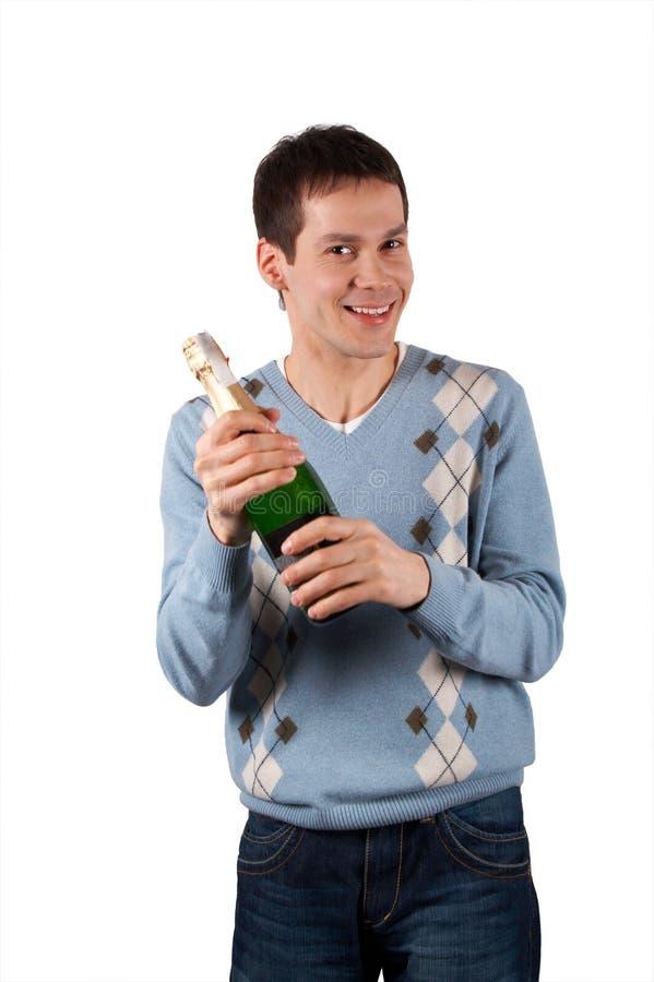 Giovane con la bottiglia di vino fotografia stock