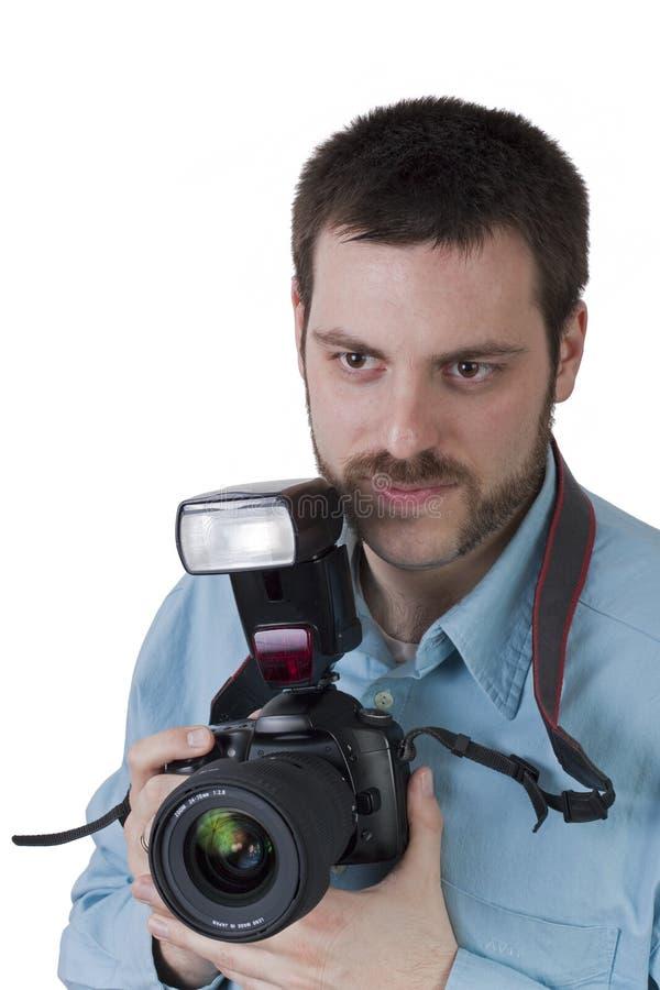 Giovane con la macchina fotografica digitale in mani fotografia stock