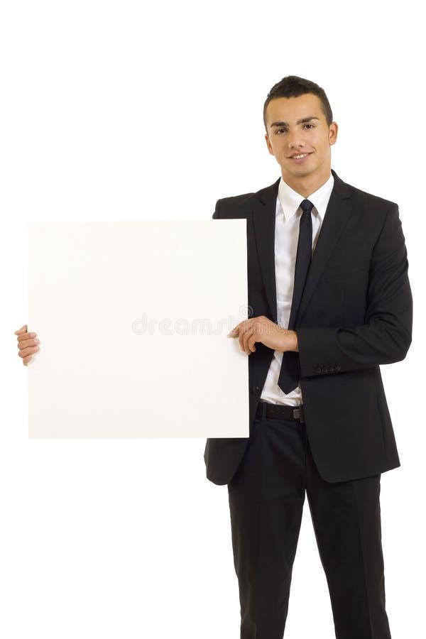 Giovane con la scheda bianca immagini stock