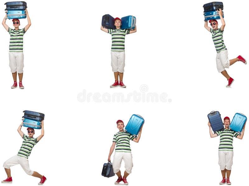 Giovane con le valigie pesanti isolate su bianco fotografie stock