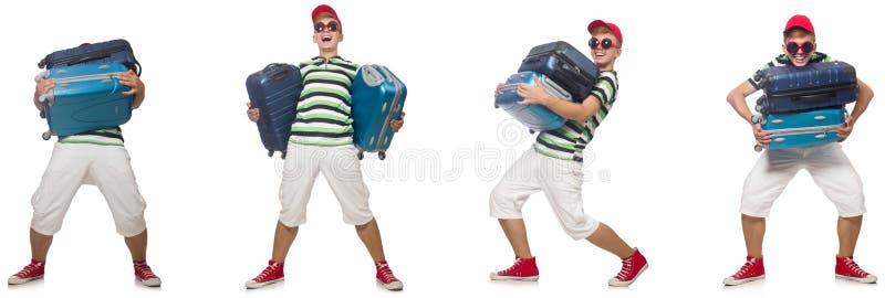 Giovane con le valigie pesanti isolate su bianco immagini stock libere da diritti