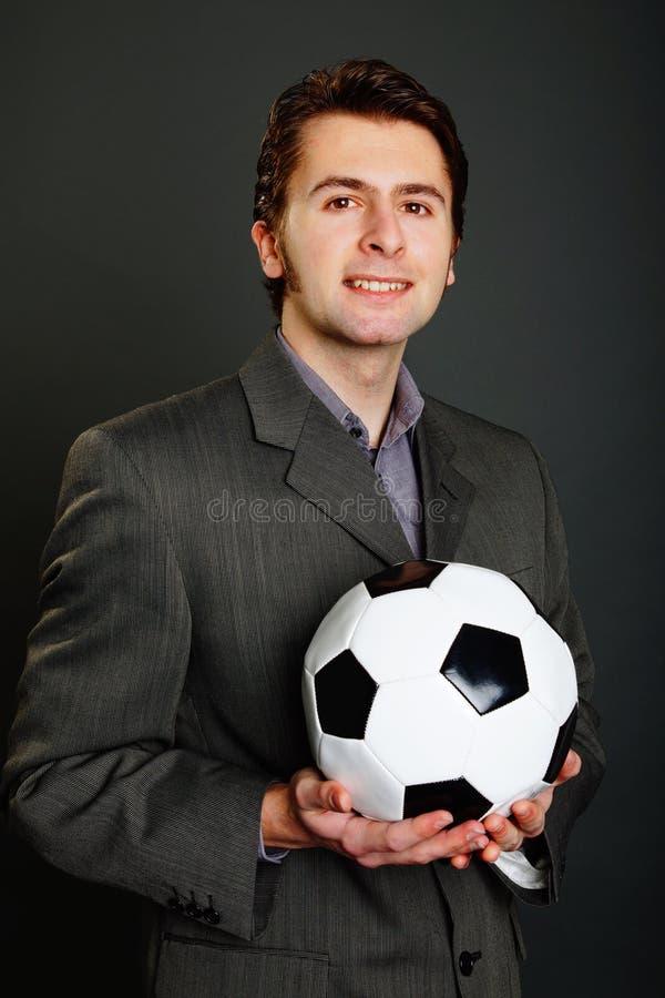 Giovane con pallone da calcio immagine stock