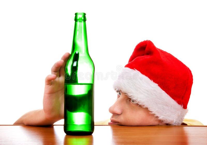 Giovane con una birra fotografia stock