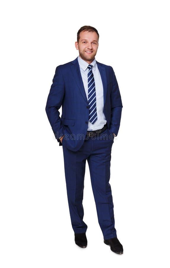 Giovane condizione dell'uomo d'affari isolata su fondo bianco fotografia stock
