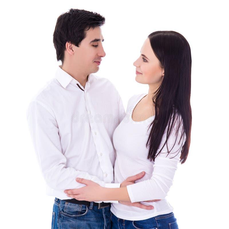 Giovane condizione delle coppie isolata su fondo bianco immagine stock libera da diritti