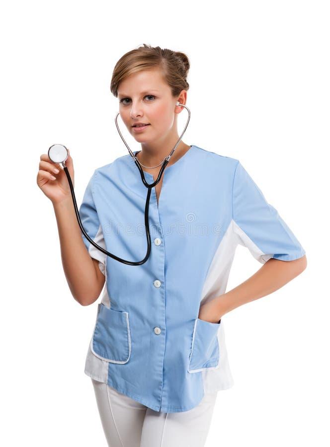 Giovane condizione di medico isolata su fondo bianco immagine stock