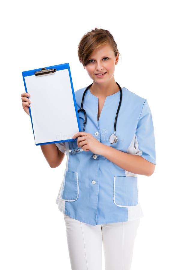 Giovane condizione di medico isolata su fondo bianco fotografie stock