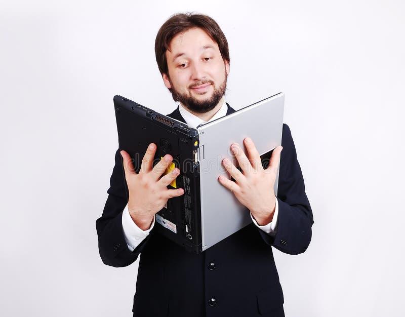 Giovane condizione maschio con il computer portatile come libro fotografie stock