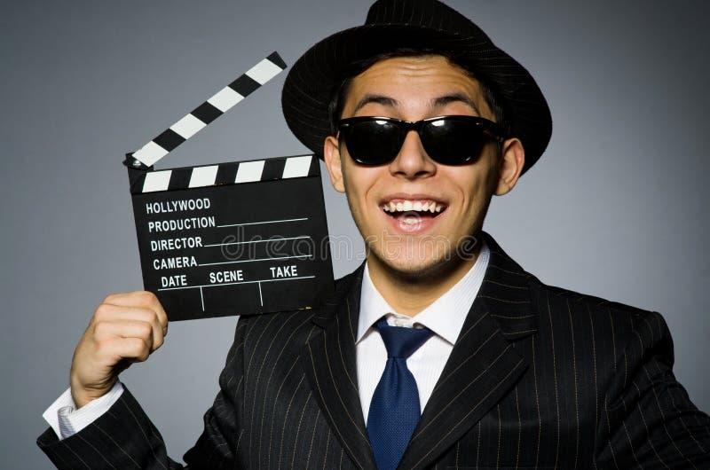Giovane in costume e cappello a strisce classici fotografia stock libera da diritti