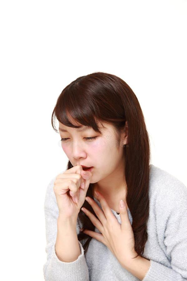 Giovane coughing  giapponese della donna fotografia stock libera da diritti