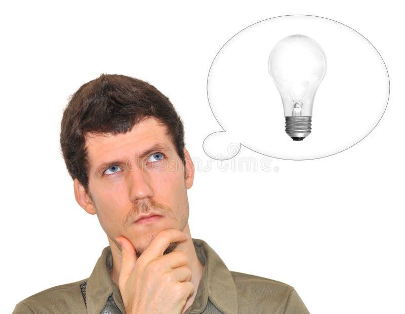 Giovane creativo che pensa ad un'idea luminosa immagine stock libera da diritti