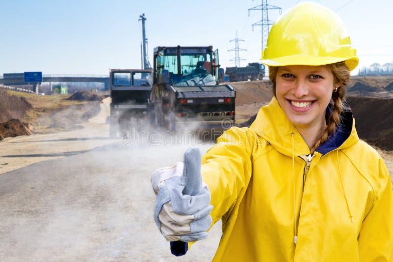 Giovane donna in abiti da lavoro immagini stock