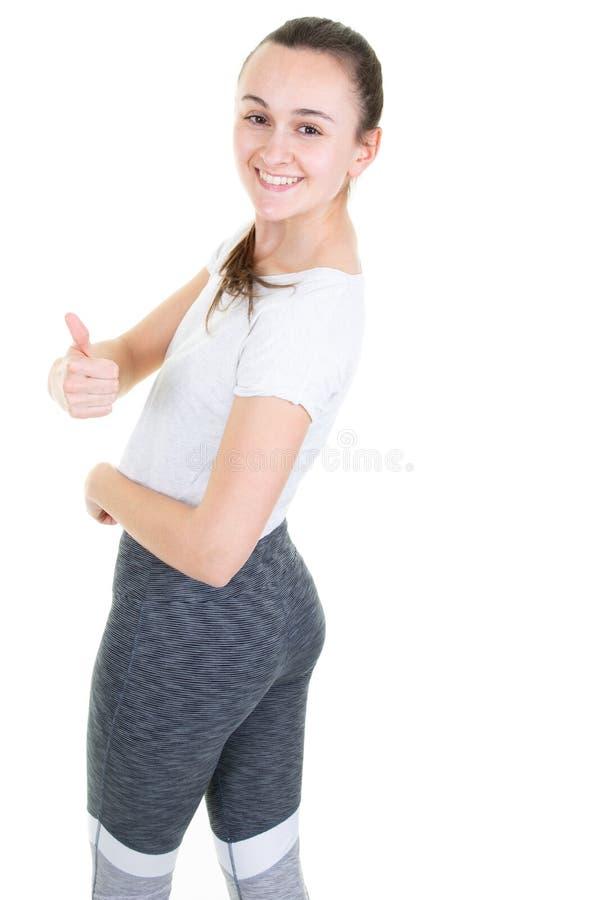 Giovane donna adatta del ritratto potente su fondo bianco isolato immagini stock